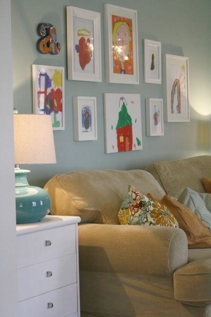 Creating a child friendly living space. Such a cute way of displaying their work