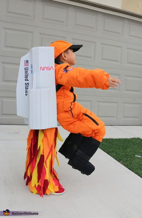 Flying Astronaut Costume - Halloween Costume Contest via Mary: Each year we pick a different theme for Halloween costumes. This year, our son's school requested peaceful hero costumes so we decided on an astronaut for him and a space.