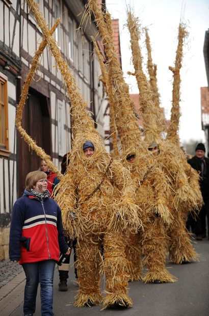 Straw bears are driven through the streets of Heldra, Germany. Winter is traditionally driven out with the straw bears in the village on the river Werra on Ash Wednesday.
