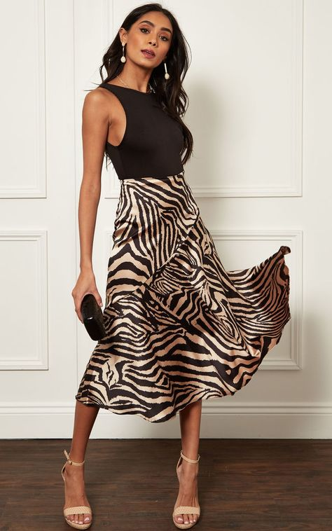 On trend animal print, luxe satin and a flattering midi length combine perfectly to give you this versatile beauty.