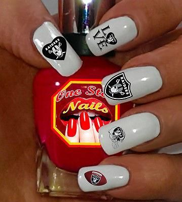 Oakland Raiders Nail Art Decals/Stickers V3. Top Quality Bright and Colorful Water Slide Nail Decals themed for Oakland Raiders.Set of 56 Oakland Raiders Nail Art Waterslide Decals. Our Nail Decals are proudly manufactured in USA. To manufacture our Nail decals for you we are using only High Quality materials and Moder