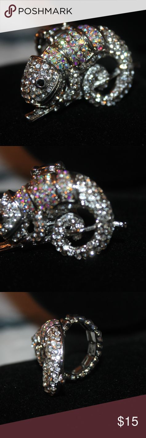 NWT Meet Ringo the Gieco Lizard Stretch Ring NWT Hi Meet Ringo the Geico Lizard Ring,  It is a Stretch Ring but I just Couldn't help my self,  I got 6 for my friends, I know they are not anything fancy but just so cute,  It will fit anyone, It is Silver Tone and has AB & Clear Crystal's.  What I love about him is that he just shine so pretty. unbranded Jewelry Rings
