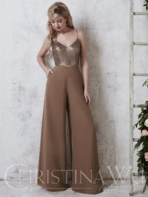 Christina Wu Celebration 22740 is a fashion forward two-piece bridesmaid pant set consisting of a Sequin sweetheart top with spaghetti straps and wide-leg Chiffon pants with lining. The pants and the top both have zipper closures.
