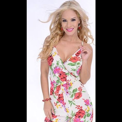Very Sexy jumpsuit print roses SZ S This jumpsuit is size S in color print roses beige/red/green/yellow not spandex only elastic in waist is fabric 100 polyester. Great Glam Dresses