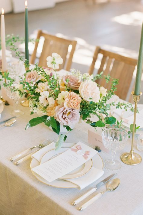 From the editorial, The Beauty of the Camellia Flower Inspired This Ultra-Feminine Shoot With Secret Garden Allure. For a more intimate dinner, @elleandjamesco's earthy yet feminine tablescape — inside the historic onsite schoolhouse — exudes a soft, romantic ambiance.   Photography @bluerosepictures #stylemepretty #weddintable #weddingreception #springwedding