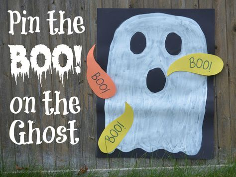 """Paint a ghost onto posterboard, and cut out a construction paper """"Boo!"""" for each child. Place rolled tape on the back of each Boo, and have the children take turns trying to pin (or tape) the Boo onto the ghost. The child whose turn it is is blindfolded. For extra fun, instead of a blindfold, use a large witch hat to cover the child's eyes."""