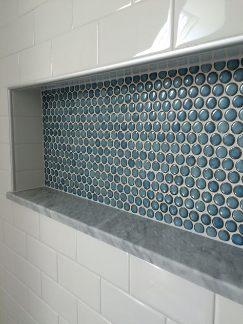custom shower detail. inset niche with penny tiles, marble base and subway tile wall.  Portland, Maine renovation. East End Carpentry. Edward Gibbs https://www.facebook.com/eastendcarpentry/