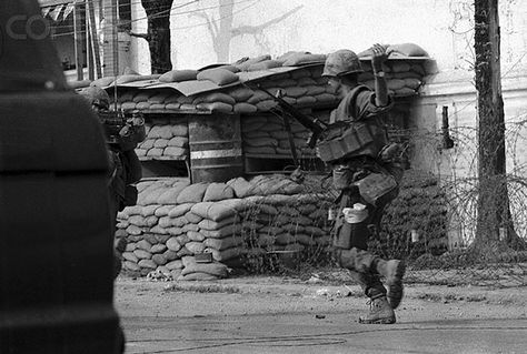 https://flic.kr/p/6F2Vwh | U1582236-19 | 22 Feb 1968, Hue, South Vietnam --- Two members of the First Air Cavalry are seen as they drag a wounded GI across Highway 1, after being ambushed by Communist forces.  The cavalrymen were moving south toward Hue when the attack occurred. --- Image by © Bettmann/CORBIS