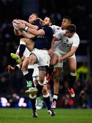 Greig Tonks of Scotland takes a high ball under pressure during the RBS Six Nations match between England and Scotland at Twickenham Stadium on March 2015 in London, England.