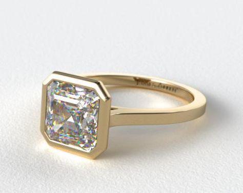 asscher cut diamond engagement ring in 18k yellow gold bezel setting