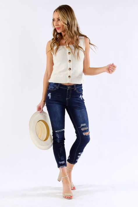 Get a new tank for summer without going the frilly route! This thick strapped tank with front button details will go perfectly with your favorite mom jeans or layered under a denim jacket for cooler evenings. 100% Polyester Hand wash cold, do not bleach, lay flat to dry Measures 22 from top of strap to hem on size small Size small is pictured Imported