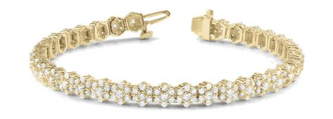 Beautiful Fancy Diamond bracelet with round diamonds set in yellow Gold. 14kt Gold feels and looks amazing with the sparkle of the diamonds that enhance your individualistic image. Pretty style that blends in all occasions and wardrobe you accompany it with. Fancy design allows you to compliment and pair other bracelets for a complete impressive look. Diamond total weights and dimensions are approximate. STONE(S) Diamond Weight: 4.39 carat tw. Color: I Clarity: I2 Guarantee: Yes with Free Warran