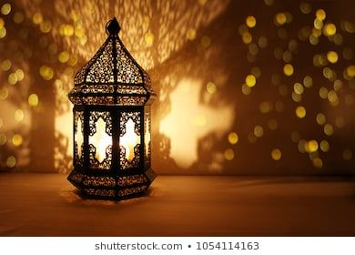 Ornamental Arabic Lantern With Burning Candle Glowing At Night And Glittering Golden Bokeh Lights Festive Greeting Car Candle Glow Burning Candle Bokeh Lights