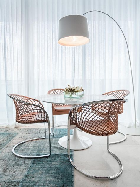 A Series Of Swoops And Curves Make This Small Dining Area Feel