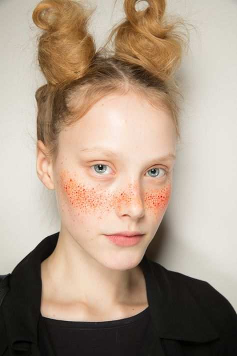 Vivienne Westwood Red LabelHair, by Mark Hampton, was equally diverse, spanning from twisted up-dos to punky top-knots and glamorous set waves.