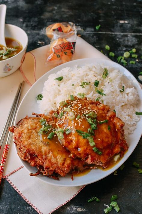 Chicken egg foo young is a classic Chinese restaurant dish of onions eggs, bean sprouts and chicken deep fried into pancakes and covered in delicious gravy. Restaurant Dishes, Chinese Restaurant, Wok Of Life, Asian Recipes, Ethnic Recipes, Chinese Recipes, Asian Foods, Chicken Eggs, Main Dishes
