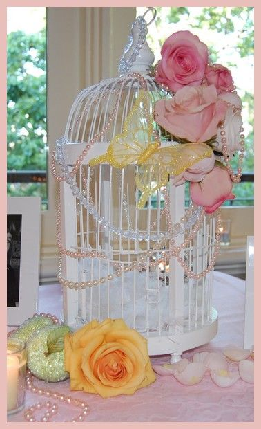 Pearls dropped over the birdcage filled with white feathers