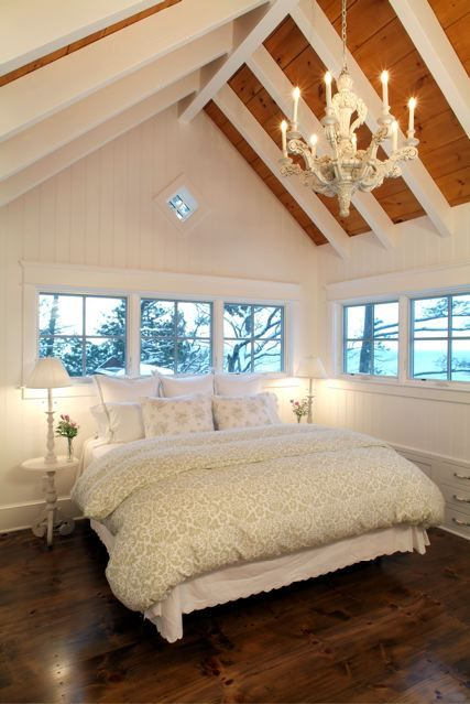 bedroom at the top of the house, windows all around. // what a beautiful, relaxing bedroom this looks like.