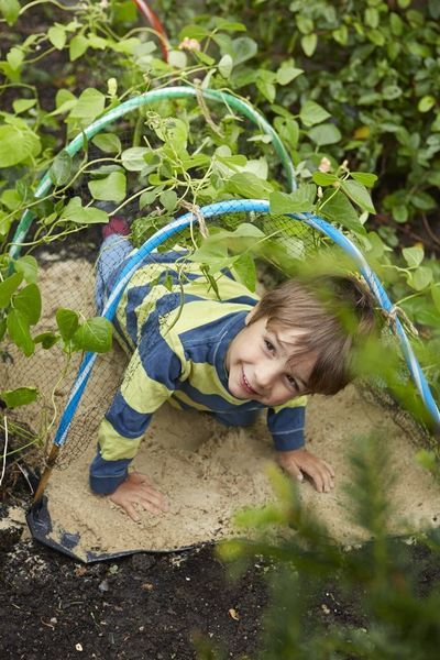 Build a crawl tunnel - one of the ideas from 101 Things For Kids To Do Outside