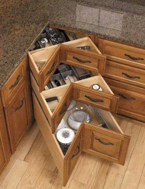 Kitchen cabinet - what to do with that pain in the neck corner?   What a great, logical and practical idea to make use of wasted space in the bottom  corner cabinet!