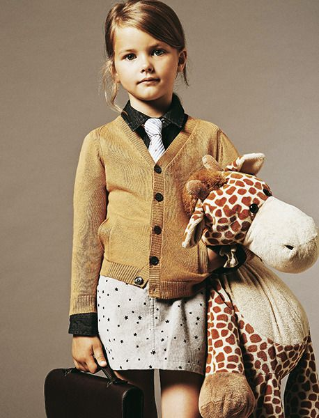 Smart girl clothing. Kids fashion and style. This kid is all business and ready for the office
