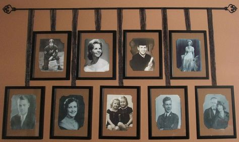 pictures hanging from decorative rods