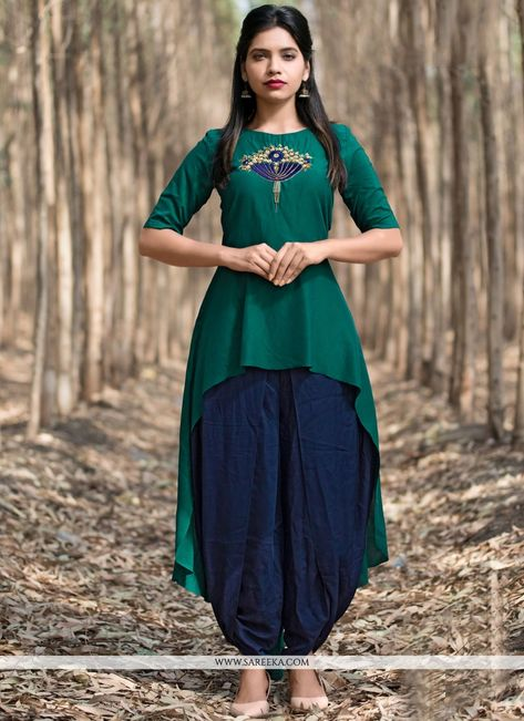 Add grace and charm towards the look in this green art silk party wear kurti. The wonderful embroidered work in the course of the attire is awe inspiring. (Slight variation in color, fabric & work is ...