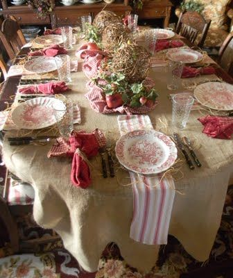 The french country dishes in red!  Glam table by French Country Cottage Blog