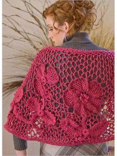 Irish crochet flowers float in a web of lace