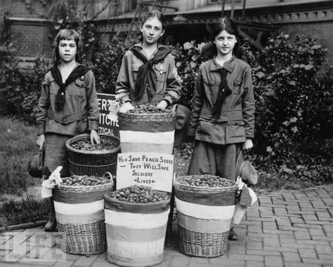 Girl Scouts in 1916 collect peach pits during World War I, which were ground up and used to filter soldiers' gas masks. Girl Scouts rock.