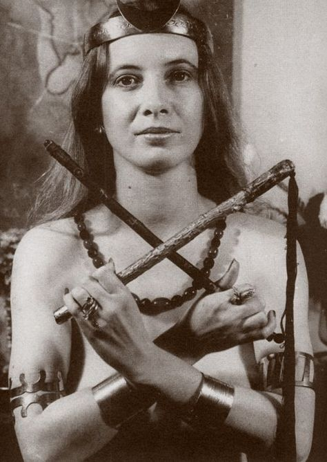 Janet Farrar Janet Farrar holds a flog and wand in quotOsiris position