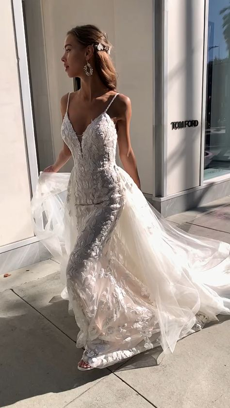 Make a dramatic entrance with Moonlight Bridal style H1452. This stunner comes with two looks, which include a mermaid silhouette and a detachable tulle train that will leave you looking majestic. Perfect for a bride that can't decide if she wants something traditional or high-fashion chic, this gown will give her both options.  #mermaidweddingdress #laceweddingdress #sparklyweddingdress #sexyweddingdress #weddingtrain