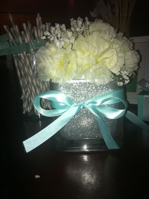 DIY Glitter Vase, With Carnation Ball and Ribbon! Simply line the vase with white glue with a paint brush, add a tablespoon of glitter, cover and shake!