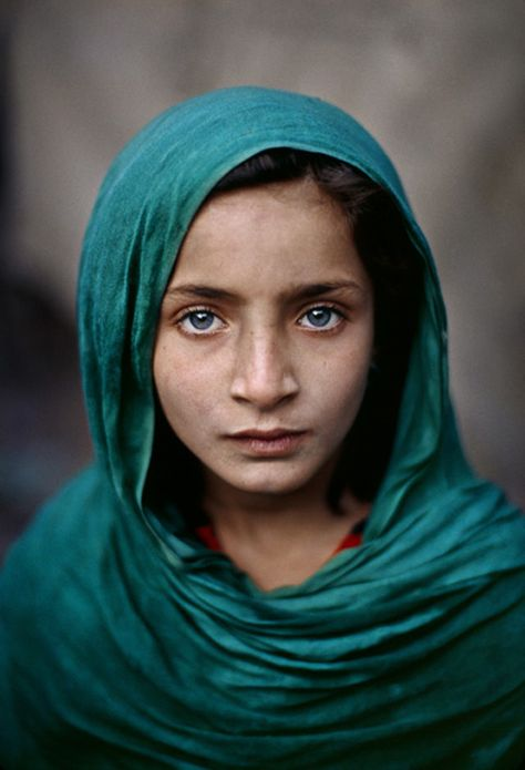 A blue-eyed girl from Pakistan. This photo was shot by Steve McCurry, the same guy that did the picture of the green-eyed Afghani girl.