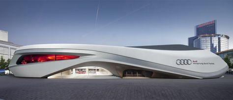 With the Audi Ring, the carmaker Audi presented itself at the Frankfurt Motor Show (IAA) in a separate, free-standing facility. At the heart of this 100 metres long, 70 metres wide, and 12 metres high trade show pavilion was .
