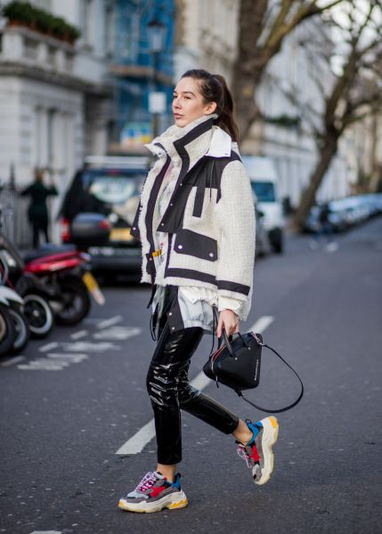 STYLECASTER Tomboy Outfits Street style star wearing leather pants and sneakers