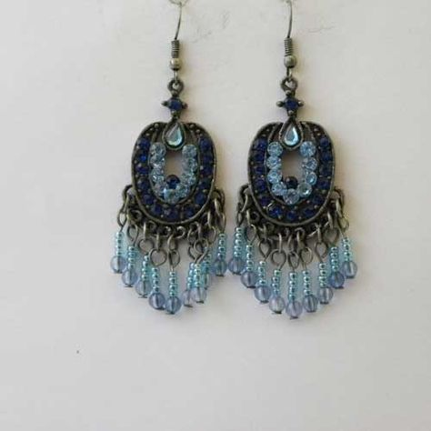 Shimmery Eastern Promise blue earrings A pair of pretty unique hippy drop earring for pierced ears in a pewter colour with light and dark blue