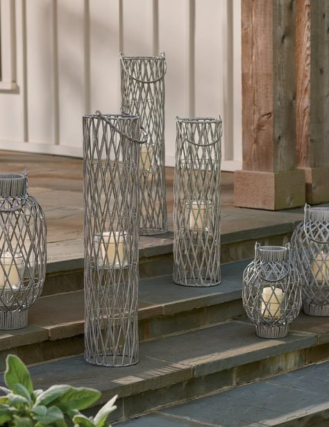 Group sizes and styles of our coastal-fresh Willow Lanterns to create dramatic light, indoors or out. Removable glass insert within protects flame easy-carry handles make it easier to rearrange for display or move light where it's needed.