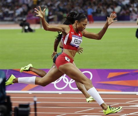 United States'  Allyson Felix, second from right, crosses the finish line to win gold in the women's 200-meter final.