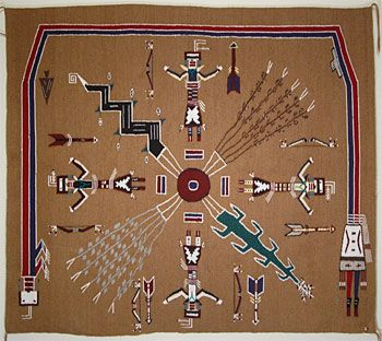 Sandpainting Rug by Zonnie Gilmore (Navajo) ~  Sandpainting rugs are based upon ceremonial sandpainting designs and are usually square in shape. The background is typically tan to reflect the color of plain sand. The images depicted are usually of supernatural beings and powerful plants and/ or animals.   This rug measures 46 inches by 51 inches.
