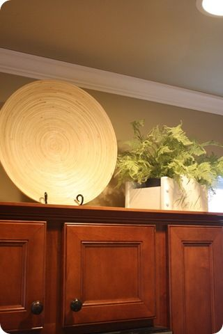Decorating Above the Kitchen Cabinets ~ Thrifty Decor ... on decor above kitchen sink, decor above windows, decor above fireplaces, decor above kitchen table, decor above mantels, decor above refrigerators, decorating top of kitchen cabinets,