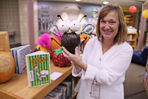 Jordan Creek Teacher Librarian Kristi Skoglund with her pumpkin character, Fly Guy.