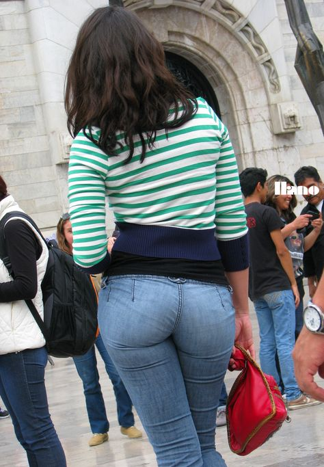 Latina brunette with tight jeans showing round and big ass