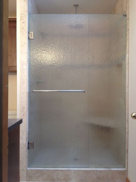This custom shower design is a beautiful elegant frameless option. Many customers choose this for their bathrooms. It's the most popular option and can work in many bathrooms. Also, people choose rain glass for privacy.