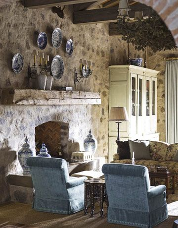 Romantic Family Room  Stone walls and large ceiling beams add a romantic atmosphere to this vacation home. Designed by Cathy Kincaid