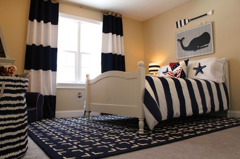 This nautical big boy room just screams @Vicki Snyder Barn Kids and we L-O-V-E it! {bed, bedside table, rug, chair, duvet cover, curtains, bookcase + more all from PBK} #bigboyroom #nautical