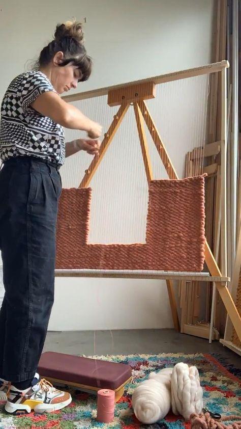 Maryanne moodie weaving at the frame loom