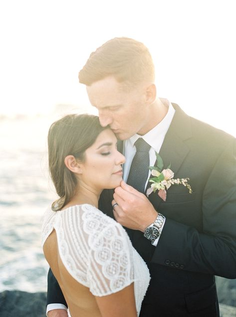 Soft and romantic boutonnière filled with hellebore, garden roses, and pieris for a late summer elopement on the beach in Dana Point by San Diego wedding florist Le Champange Projects