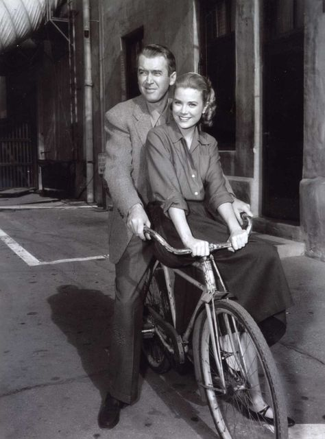 """1954 --- Actress Grace Kelly and actor James Stewart on the set of """"Rear Window"""""""