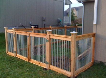 Cedar And Metal Fence Have Two Small Dogs House Dogs That Do Not Need A Large Outside Area To Run And Do The Backyard Dog Area Diy Dog Fence Backyard Fences